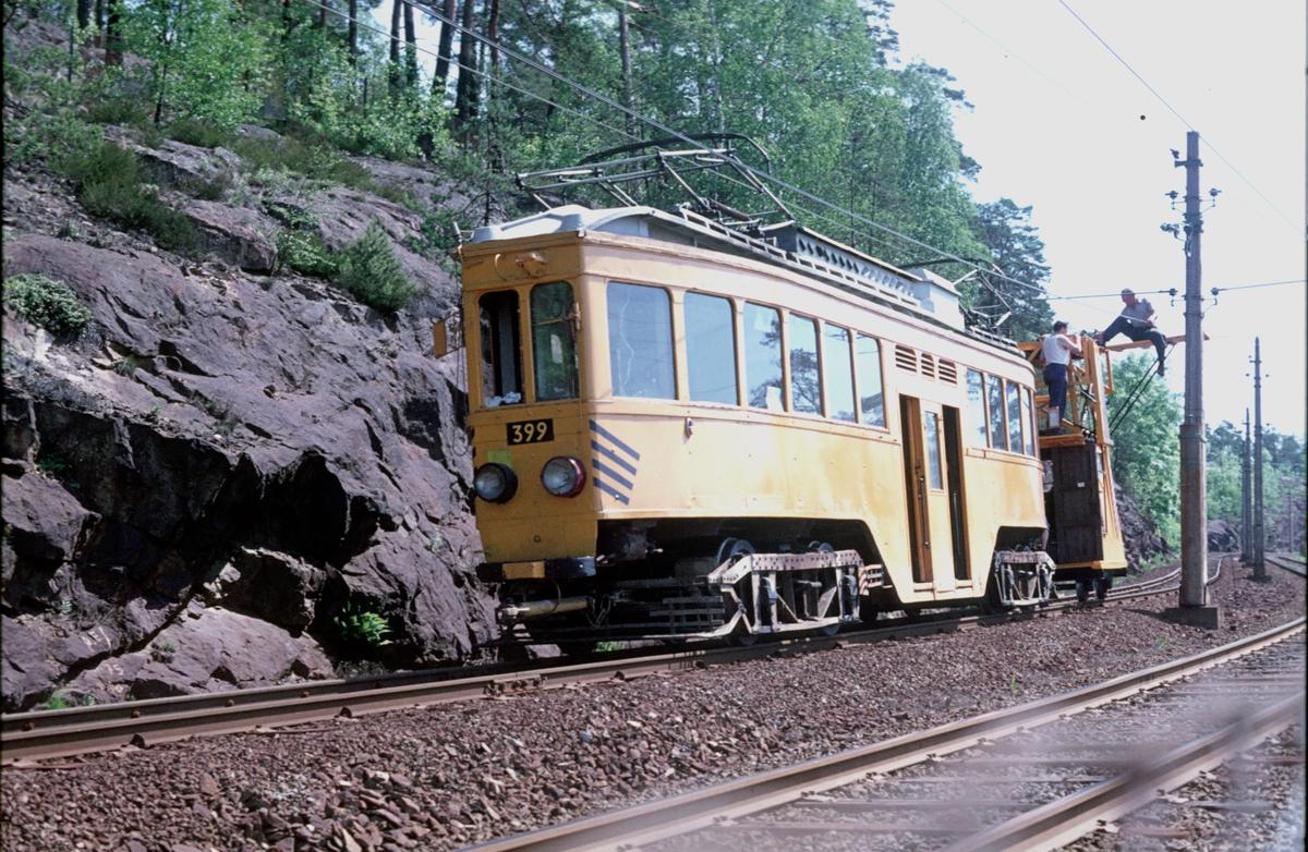 Ekebergbanen, Oslo Sporveier. Arbeidsvogn 399, opprinnelig vogn 1007 fra 1920. Arbeid på ledning. Forsterkning av ledningsnettet for ombygging fra 1200V til 600V.