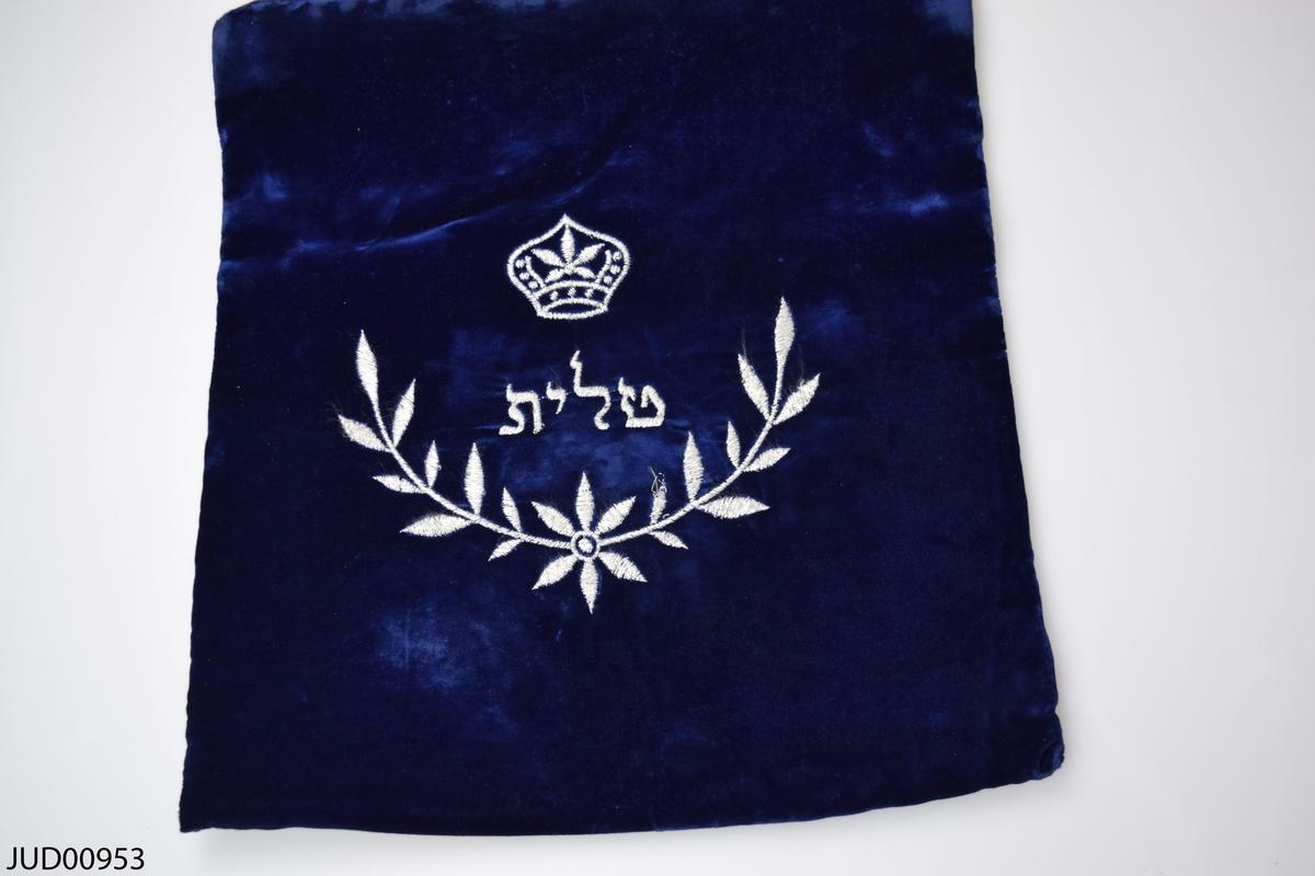 Krona samt blomsterkvist med ordet tallit på hebreiska  i mitten.