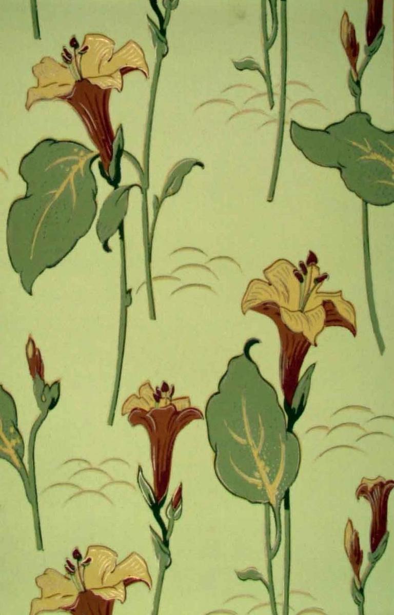 Ett storfigurigt vackert jugendmönster med liljeliknande blommor i senapsgult och guld samt i två nyanser chokladbrunt och olivgrönt på ofärgat papper. Vacker tapet.