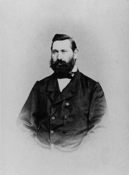 Porträtt av Bernhard Hörlin, en man med stort skägg.