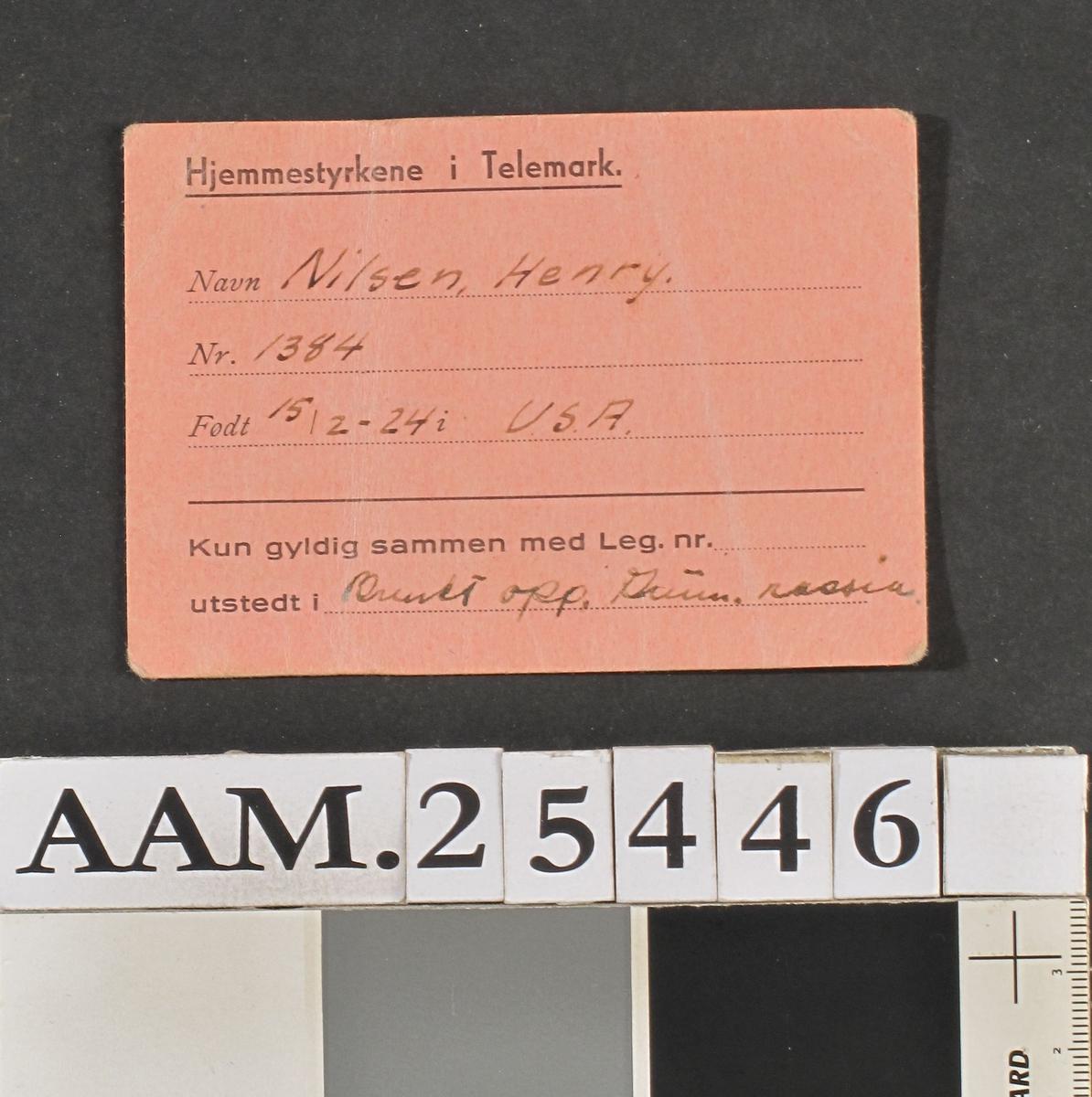 Rektangulært kort med trykt skjema tekst og håndskrift.