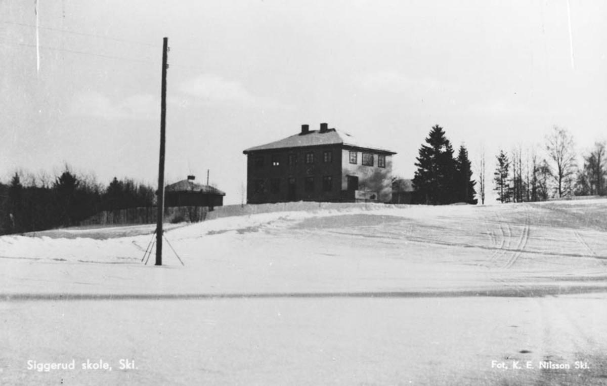 Siggerud nye skole etter Ø B Klisjè 12 x 7 cm.