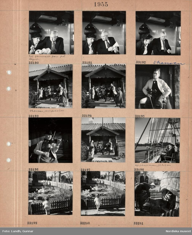 """Motiv: (ingen anteckning) ; Interiör av ett tåg med en kvinna och en man i en tågkupé """"Ett gammalt par på tåget"""", en pojke och en flicka tittar på två män i folkdräkt som sitter på en veranda och spelar fiol, porträtt av en man med fiol, människor sitter i stolar på däcket på ett fartyg """"af Chapman, Sthlm"""", ett barn tittar på fåglar som går i en inhägnad, en kvinna med getter i en inhägnad."""