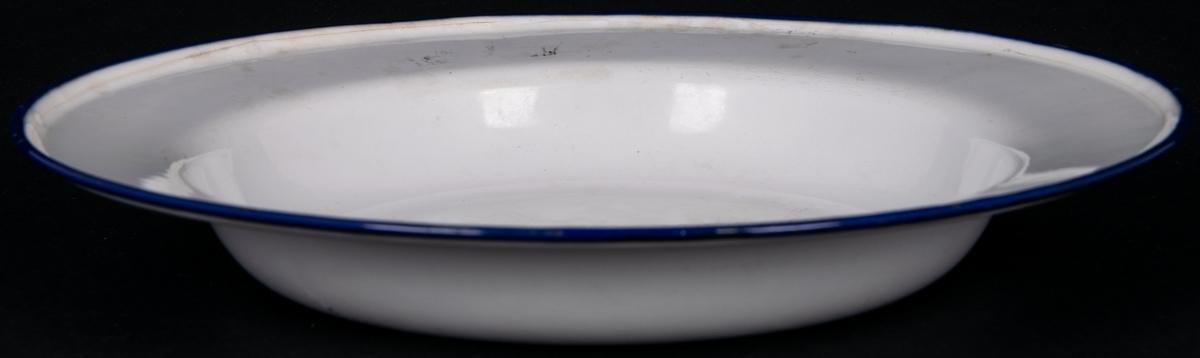 Tallrik, djup, emalj, vit med blå kant. På undersidan märke; Cirkel med emblem, KRP samt SWEDEN,  20cm. Emaljen skadad.