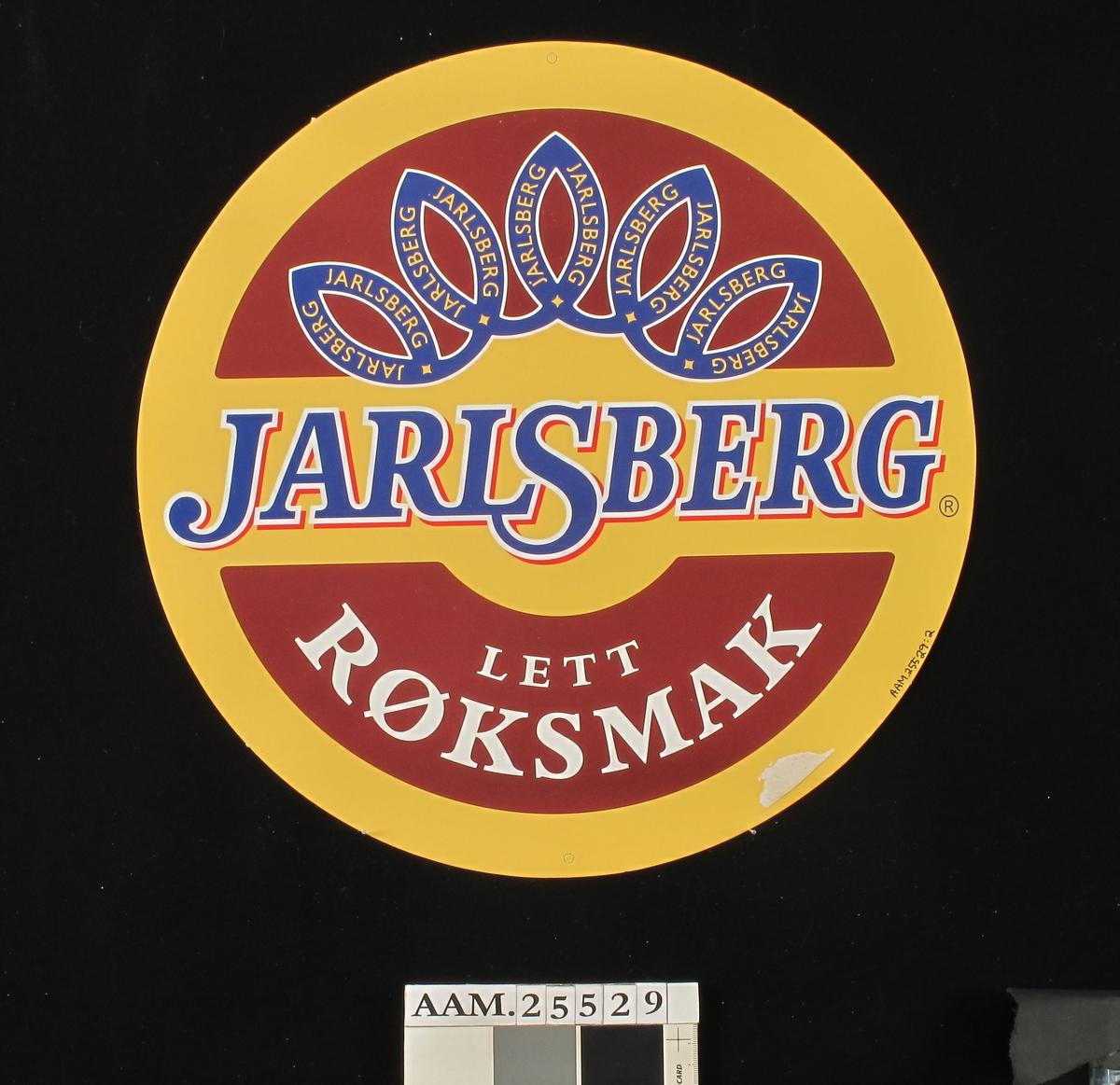 Rund Jarsberg-ost / fargefoto av ostestykker.