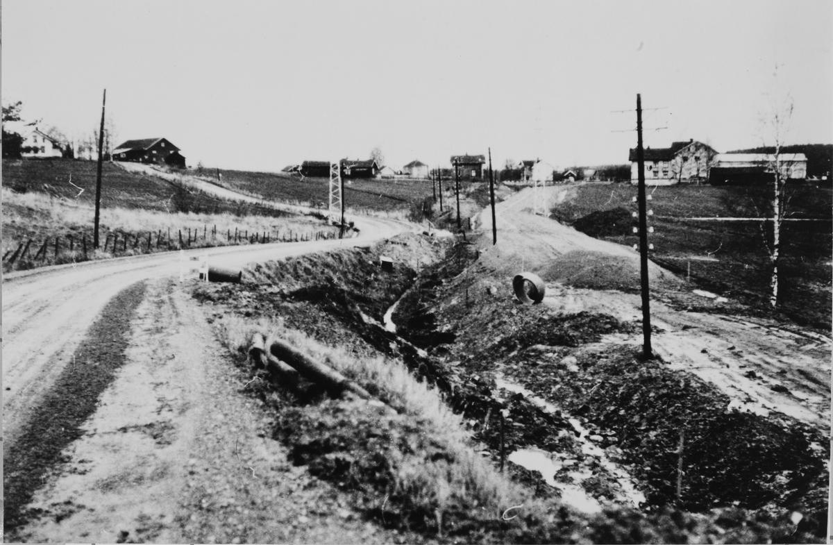 Bygging av ny vei - Kompveien - langs Tertittens gamle trase ved Lierfoss.